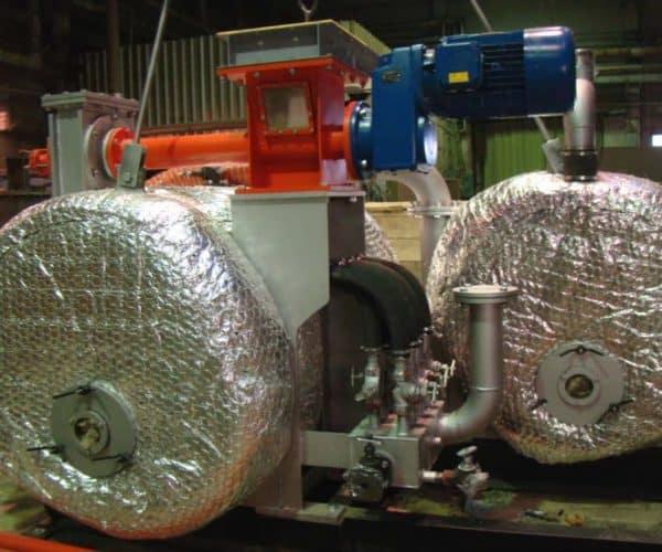 Получение тепловой и электрической энергии из древесных отходов естественной влажности.